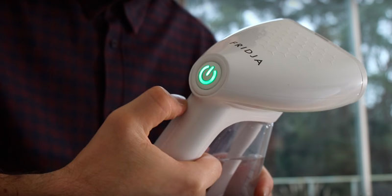Fridja F10 Handheld Clothes Steamer in the use