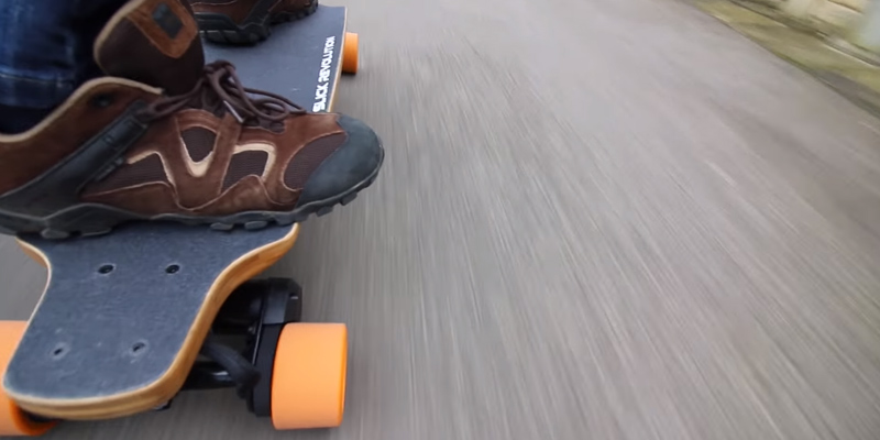 SLICK Max-Eboard Electric Longboard in the use