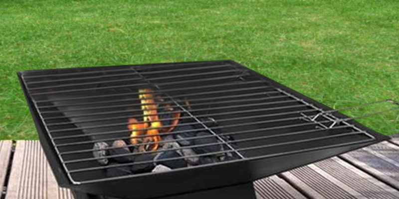 Garden Mile® Square Metal BBQ/ Fire Pit in the use