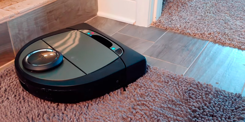 Neato Robotics D701 robot vacuum cleaner with charging station in the use